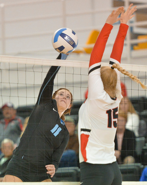 Justin Sheely | The Sheridan Press<br /> Lady Generals' Ally Gates slams one against Western Wyoming during the first round of the Region IX Tournament Wednesday in the Bruce Hoffman Golden Dome at Sheridan College. Sheridan won the four set match against the Lady Mustangs.