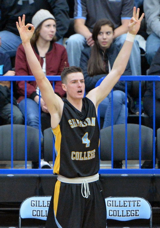 Ladan Ricketts celebrates a teammate's 3-pointer from the sideline on Wednesday, Jan. 11 at the Pronghorn Center in Gillette. Mike Pruden | The Sheridan Press
