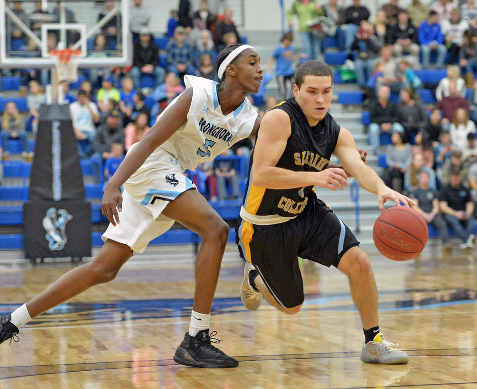 Gillette College's Abdul Mohamed, left, tries to poke the ball away from Sheridan College point guard Celio Araujo on Wednesday, Jan. 11 at the Pronghorn Center in Gillette. Mike Pruden | The Sheridan Press