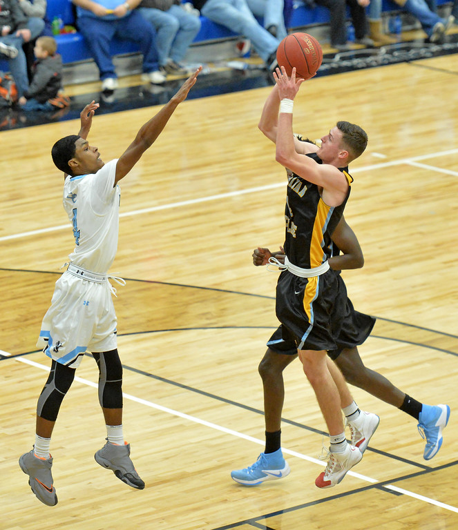 Ladan Ricketts shoots the ball over Gillette College's Ted McCree on Wednesday, Jan. 11 at the Pronghorn Center in Gillette. Mike Pruden | The Sheridan Press