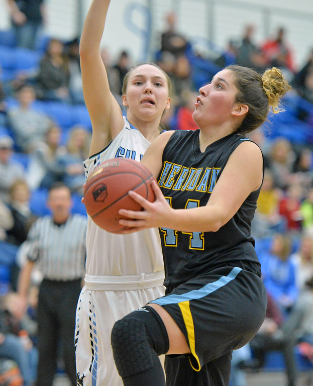 Mar Lamadrid Coll, right, scoops a layup under Gillette College's Angie Murnion on Wednesday, Jan. 11 at the Pronghorn Center in Gillette. Mike Pruden | The Sheridan Press
