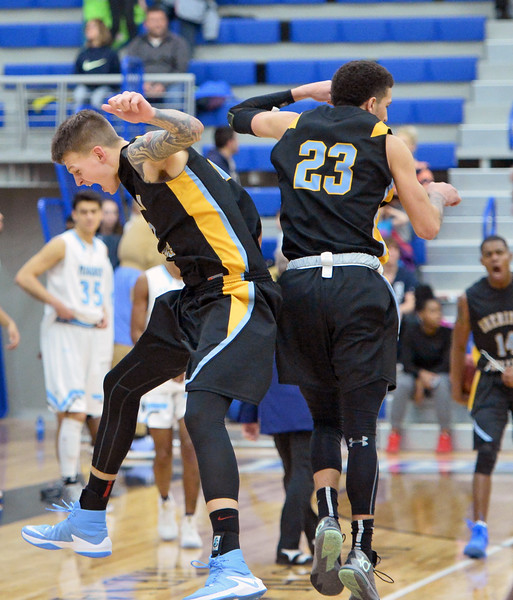 Sheridan College's Sebastian Ferenc, left, celebrates with teammate Channel Banks after the Generals knocked of 12th-ranked Gillette College on Wednesday, Jan. 11 at the Pronghorn Center in Gillette. Mike Pruden | The Sheridan Press