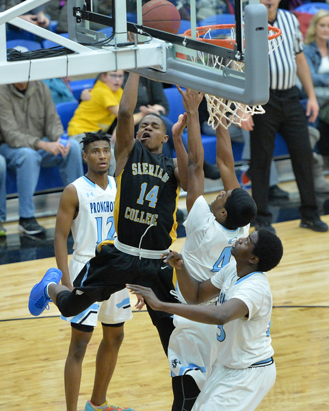 Xavier Jackson shoots a contested floater on Wednesday, Jan. 11 at the Pronghorn Center in Gillette. Mike Pruden   The Sheridan Press