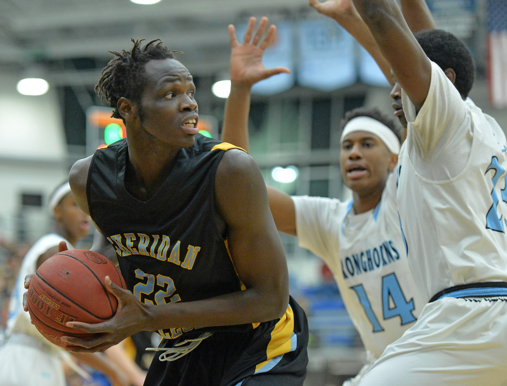 Elhadji Dieng, left, looks to make a post move around a Gillette College double team on Wednesday, Jan. 11 at the Pronghorn Center in Gillette. Mike Pruden | The Sheridan Press