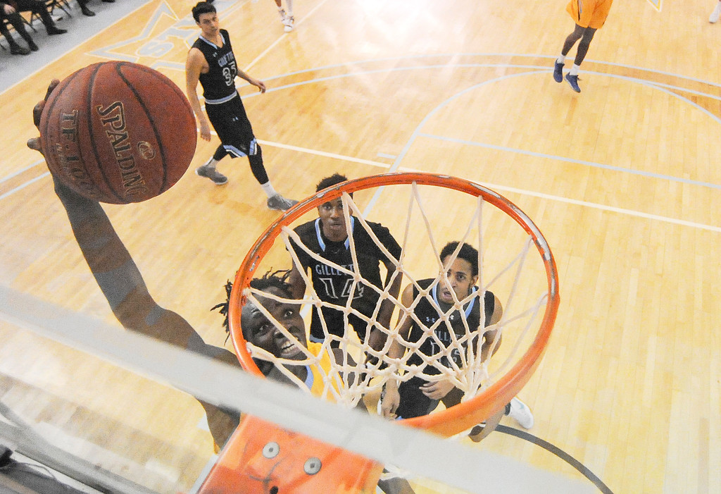 Justin Sheely | The Sheridan Press<br /> Sheridan College's Elhadji Dieng slams one over the Pronghorns during the rivalry game Wednesday night at the Sheridan College Golden Dome. The Generals fell to Gillette 87-81.