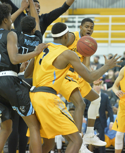 Justin Sheely | The Sheridan Press<br /> Sheridan College's Xavier Jackson, right, passes the ball to Darius Jackson during the rivalry game against the Pronghorns Wednesday night at the Bruce Hoffman Golden Dome. The Generals fell to Gillette 87-81.