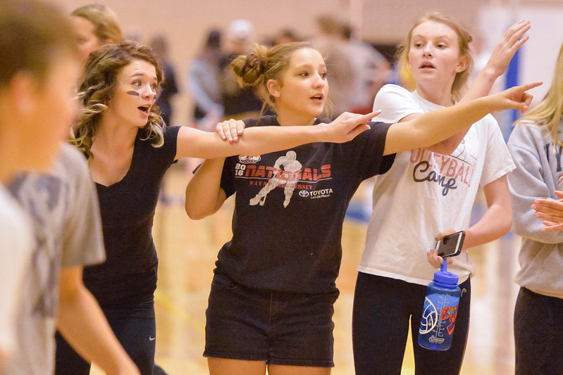 Justin Sheely | The Sheridan Press<br /> Sheridan freshman Alyie Williamson, left, MacKenzie Boyles and Taylor Larson direct the freshman boys against the seniors in He-Man Volleyball on Homecoming week Tuesday at Sheridan High School.