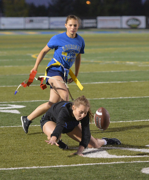 Justin Sheely | The Sheridan Press<br /> Sophomore Tasha Rozman tags senior Alli Purri at powderpuff football during Sheridan's homecoming week Wednesday at Scott Field. The junior class beat the seniors in the winners' game 18-12. The pep rally is Thursday night on Grinnell Plaza.