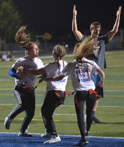 Justin Sheely | The Sheridan Press<br /> Juniors Taylor Lee, left, Braylee Standish and Staci Anne celebrate in the endzone at powderpuff football during Sheridan's homecoming week Wednesday at Scott Field. The junior class beat the seniors in the winners' game 18-12. The pep rally is Thursday night on Grinnell Plaza.