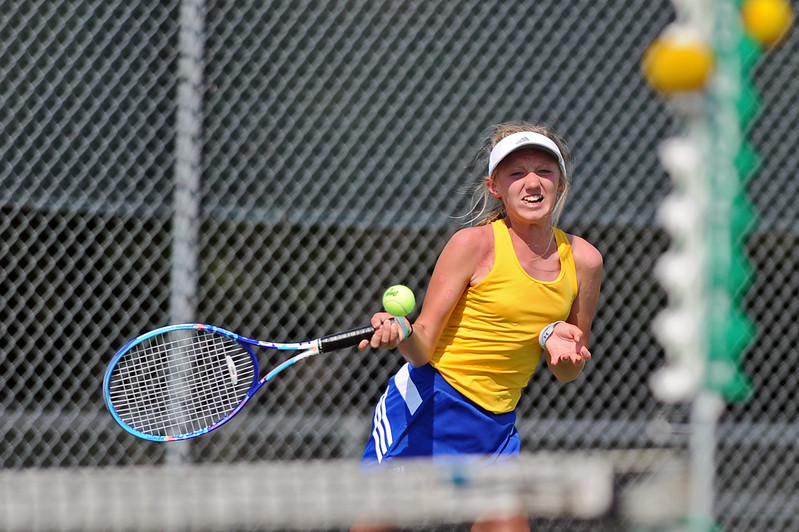 Ella Laird steps into a forehand against Powell on Friday, Aug. 18 at Sheridan High School. Mike Pruden | The Sheridan Press
