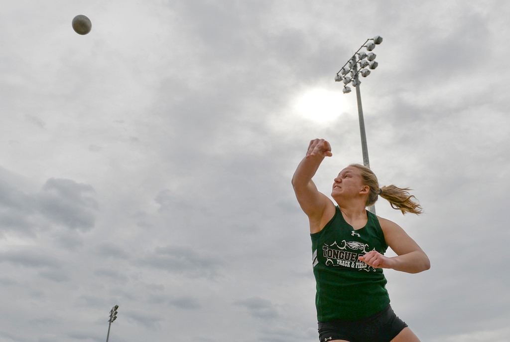 Justin Sheely | The Sheridan Press<br /> Tongue River's Courtney Good competes in shot put during the pre-prom track and field invite Friday at Tongue River High School in Dayton.