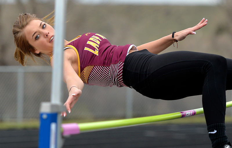 Justin Sheely | The Sheridan Press<br /> Big Horn's Alisyn Hutton clears the high jump during the pre-prom track and field invite Friday at Tongue River High School in Dayton.