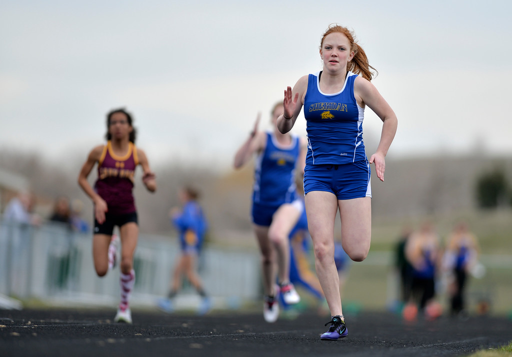 Justin Sheely | The Sheridan Press<br /> Sheridan's Alicia Thoney competes in the 100m hurdles during the pre-prom track and field invite Friday at Tongue River High School in Dayton.