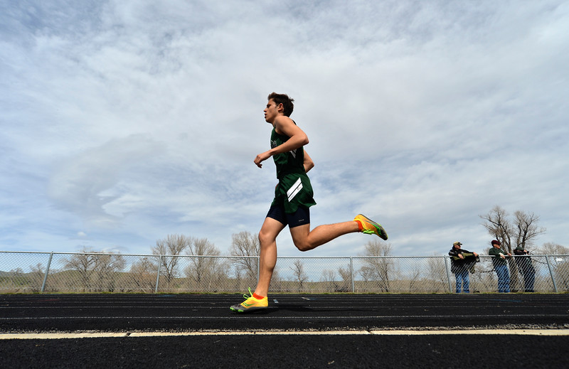 Justin Sheely | The Sheridan Press<br /> A Tongue River athlete competes in the 1600m run during the pre-prom track and field invite Friday at Tongue River High School in Dayton.