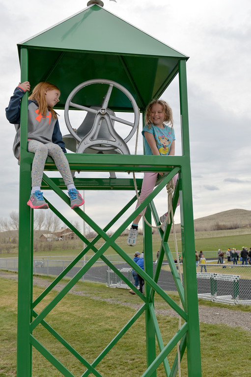 Justin Sheely | The Sheridan Press<br /> Seven-year-olds Laken Walker, left, and Jayden Pepin play in the bell tower during the pre-prom track and field invite Friday at Tongue River High School in Dayton.