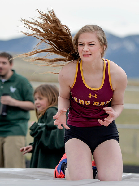Justin Sheely | The Sheridan Press<br /> Big Horn's Carley Motsick reacts after the bar falls down in the high jump during the pre-prom track and field invite Friday at Tongue River High School in Dayton.