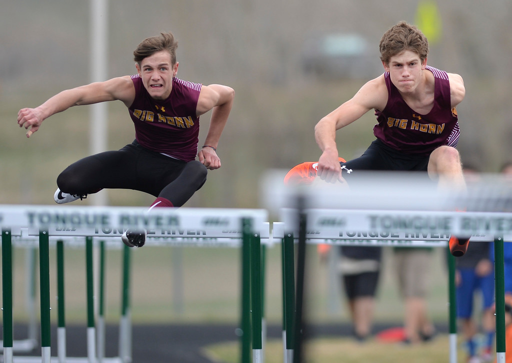 Justin Sheely | The Sheridan Press<br /> Big Horn's William Greenelsh, left, and Tanner Warder compete in the 100m hurdles during the pre-prom track and field invite Friday at Tongue River High School in Dayton.