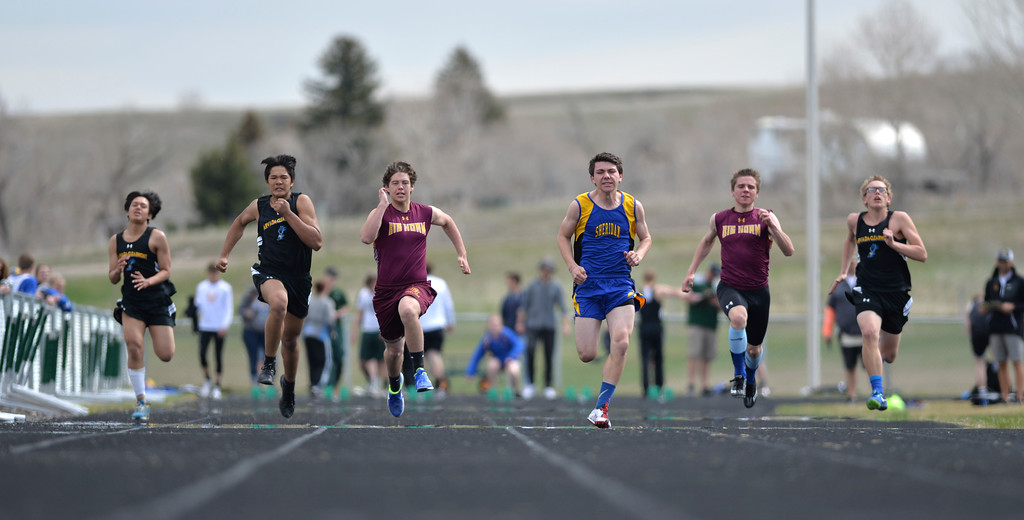 Justin Sheely | The Sheridan Press<br /> Boys compete in the 100m dash during the pre-prom track and field invite Friday at Tongue River High School in Dayton.