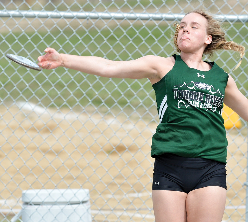 Mike Dunn | The Sheridan Press<br /> Courtney Good throws the discus Friday during the Pre Prom Invite at Tongue River High School.