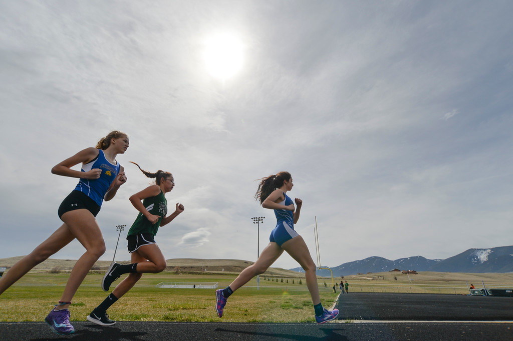 Justin Sheely | The Sheridan Press<br /> Girls compete in the 1600m run during the pre-prom track and field invite Friday at Tongue River High School in Dayton.
