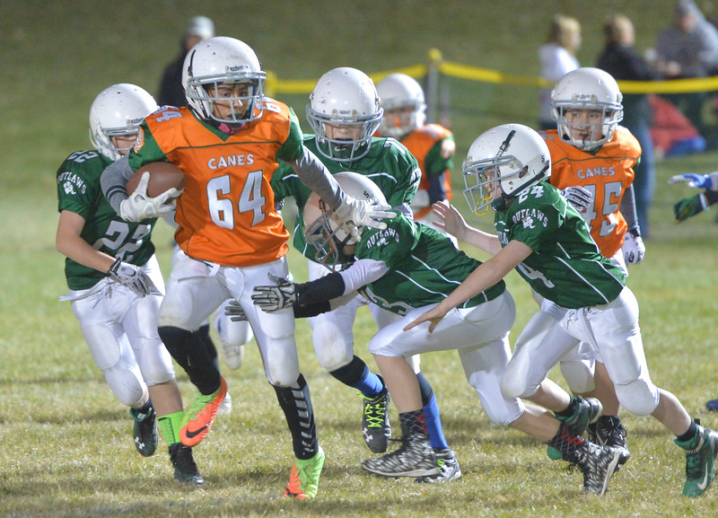Justin Sheely | The Sheridan Press<br /> Canes' Nahir Aguirre runs the ball against the Tongue River Outlaws Tuesday for the Sheridan Recreation District 5th and 6th grade Little Guy Football Championship at Dan Madia Field. The Outlaws were tied 0-0 in a defensive battle against the Canes into the fourth quarter. Momentum turned when Tongue River caught an interception late in the fourth quarter and the Outlaws offence rallied to win 8-0 in overtime.