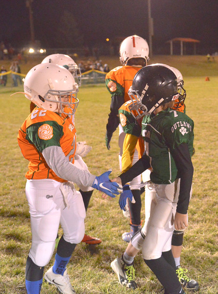 Justin Sheely | The Sheridan Press<br /> Canes' Kolin Custis, left, shakes hands with Tongue Rivers Connor Cummins Tuesday for the Sheridan Recreation District 5th and 6th grade Little Guy Football Championship at Dan Madia Field. The Outlaws were tied 0-0 in a defensive battle against the Canes into the fourth quarter. Momentum turned when Tongue River caught an interception late in the fourth quarter and the Outlaws offence rallied to win 8-0 in overtime.