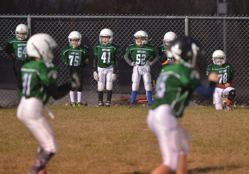 Justin Sheely | The Sheridan Press<br /> The Tongue River Outlaws practice some moves prior to the Sheridan Recreation District 5th and 6th grade Little Guy Football Championship Tuesday night at Dan Madia Field. The Outlaws were tied 0-0 in a defensive battle against the Canes into the fourth quarter. Momentum turned when Tongue River caught an interception late in the fourth quarter and the Outlaws offence rallied to win 8-0 in overtime.