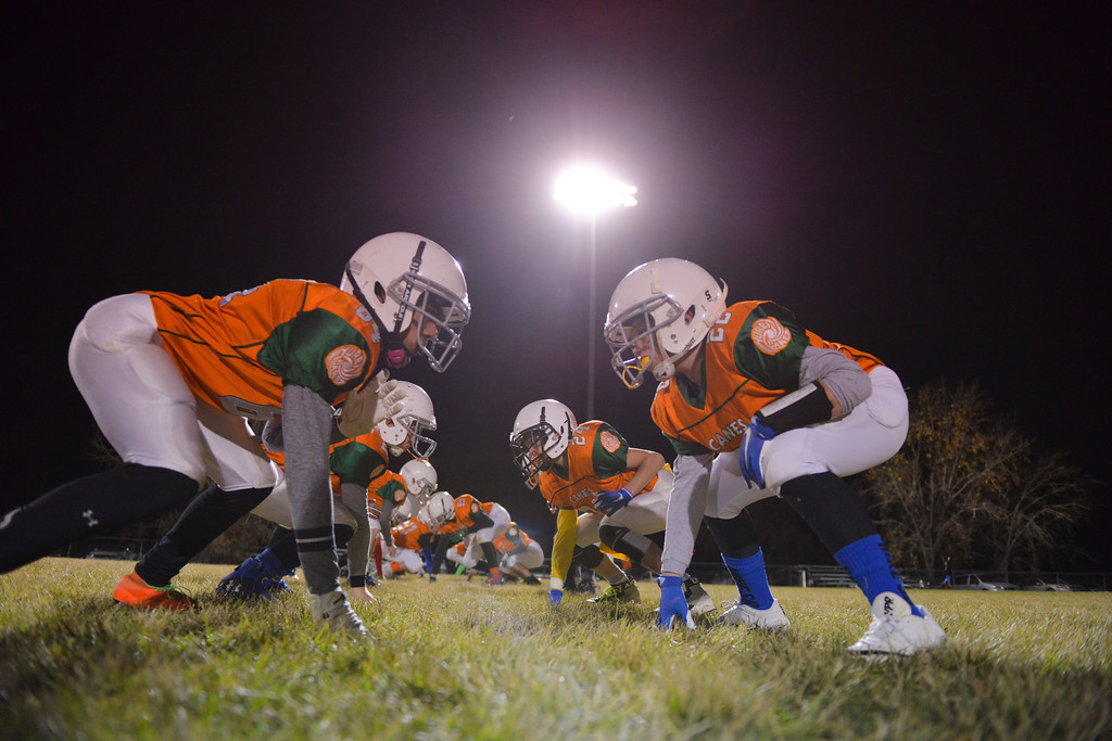 Justin Sheely | The Sheridan Press<br /> The Canes practice blocking prior to the Sheridan Recreation District 5th and 6th grade Little Guy Football Championship Tuesday night at Dan Madia Field. The Outlaws were tied 0-0 in a defensive battle against the Canes into the fourth quarter. Momentum turned when Tongue River caught an interception late in the fourth quarter and the Outlaws offence rallied to win 8-0 in overtime.