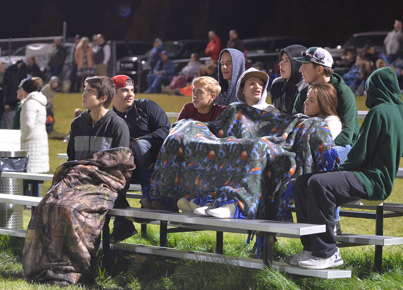 Justin Sheely | The Sheridan Press<br /> Tongue River students watch the action Tuesday night at the Sheridan Recreation District 5th and 6th grade Little Guy Football Championship at Dan Madia Field. The Outlaws were tied 0-0 in a defensive battle against the Canes into the fourth quarter. Momentum turned when Tongue River caught an interception late in the fourth quarter and the Outlaws offence rallied to win 8-0 in overtime.