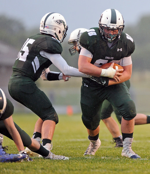 Kyler Heiling, right, takes a handoff from quarterback Luke Stutzman on Friday, Sept. 15 at Tongue RIver High School. Heiling accounted for three Tongue River touchdowns in the team's 48-0 victory over Shoshoni. Mike Pruden   The Sheridan Press