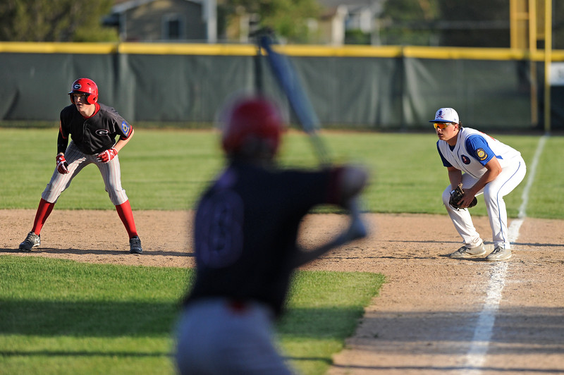 Connor Jorgenson, right, holds a runner at first base during Sheridan's 9-6 victory over Gillette on Wednesday, May 31 at Thorne-Rider Stadium. Mike Pruden | The Sheridan Press