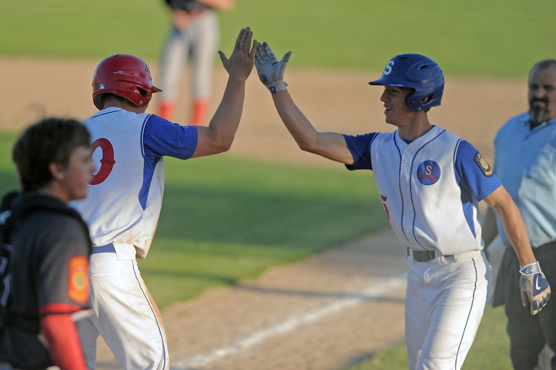 Jeff Shanor, right, high fives Nolan McCafferty after scoring two runs during a 7-run rally in Sheridan's 9-6 victory over Gillette on Wednesday, May 31 at Thorne-Rider Stadium. Mike Pruden | The Sheridan Press