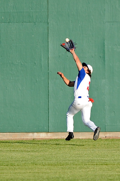 Center fielder Blake King reaches for a catch near the wall on Wednesday, May 31 at Thorne-Rider Stadium. Mike Pruden | The Sheridan Press