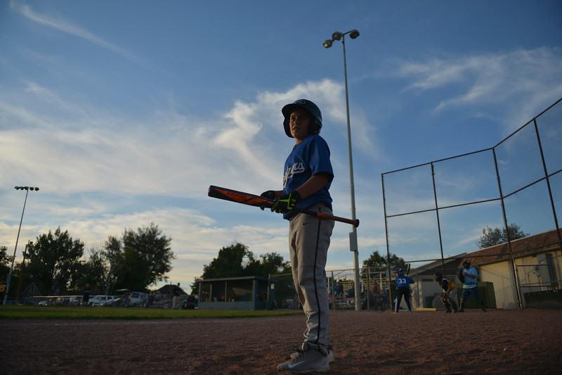 Justin Sheely | The Sheridan Press <br /> Dodgers' Mark Gilbert practices his swings during the last regular season Webb Wright League game Thursday at the 6th Street Fields in Sheridan. The team from Busby, Montana, beat Sheridan's Dodgers 3-1. The playoffs begin next week.