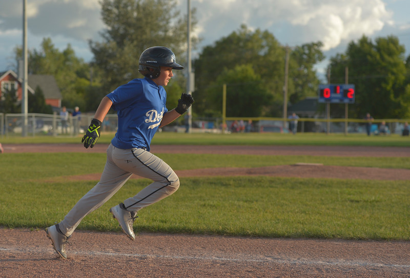 Justin Sheely | The Sheridan Press <br /> Dodgers' Mark Gilbert runs to first during the last regular season Webb Wright League game Thursday at the 6th Street Fields in Sheridan. The team from Busby, Montana, beat Sheridan's Dodgers 3-1. The playoffs begin next week.
