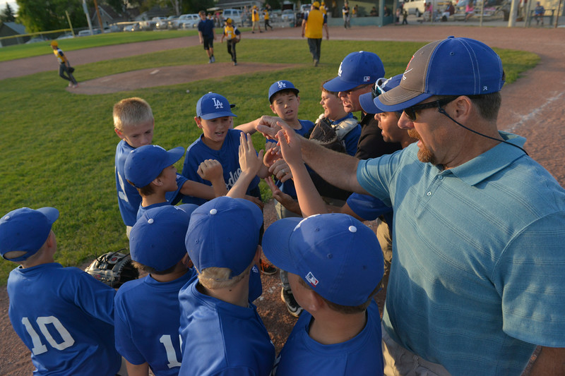 Justin Sheely | The Sheridan Press <br /> The Dodgers huddle at the end of an inning during the last regular season Webb Wright League game Thursday at the 6th Street Fields in Sheridan. The team from Busby, Montana, beat Sheridan's Dodgers 3-1. The playoffs begin next week.