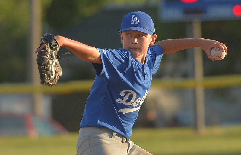 Justin Sheely | The Sheridan Press <br /> Dodgers' pitcher Tyler Hutton throws the ball during the last regular season Webb Wright League game Thursday at the 6th Street Fields in Sheridan. The team from Busby, Montana, beat Sheridan's Dodgers 3-1. The playoffs begin next week.