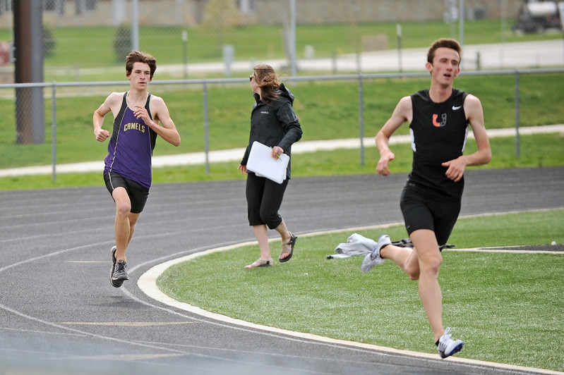 Tristan Knottnerus, left, chases Billings Senior High's Dawson LaRance in the 1600-meter run during the Gary Benson Memorial track meet on Tuesday, April 18 in Sheridan. LaRance and Knottnerus finished first and second, respectively. Mike Pruden | The Sheridan Press