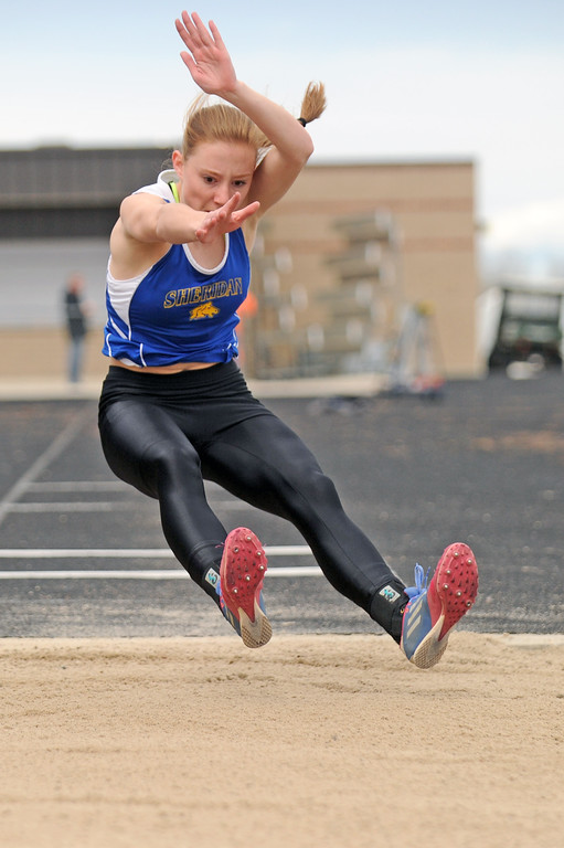 Peyton Bomar reaches for a few extra inches in the long jump during the Gary Benson Memorial track meet on Tuesday, April 18 at Sheridan High School. Mike Pruden | The Sheridan Press