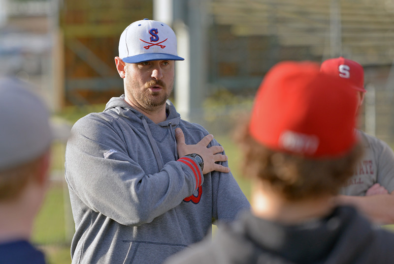 Sheridan Troopers head coach Ben Phillips goes over signs during practice on Monday, April 3 at Thorne-Rider Stadium. Mike Pruden | The Sheridan Press
