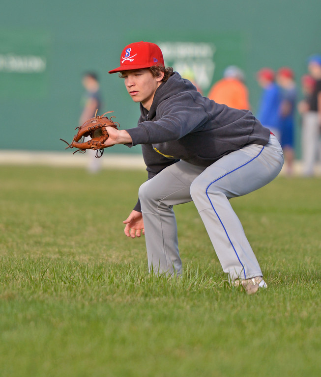 Kade Eisele goes low to make a catch during a drill at Sheridan Troopers practice on Monday, April 3 at Thorne-Rider Stadium. Mike Pruden | The Sheridan Press