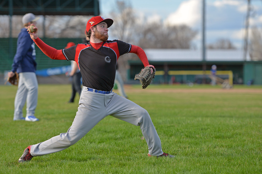 Race Johnston lunges into a throw during Troopers practice on Monday, April 3 at Thorne-Rider Stadium. Mike Pruden | The Sheridan Press