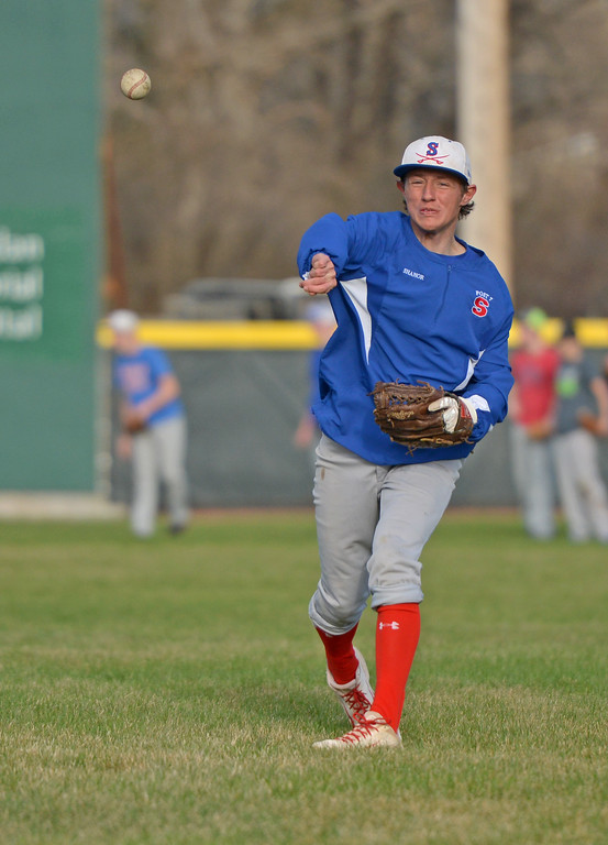 Jeffrey Shanor makes a throw during a pick-off drill on Monday, April 3 at Thorne-Rider Stadium. Mike Pruden | The Sheridan Press