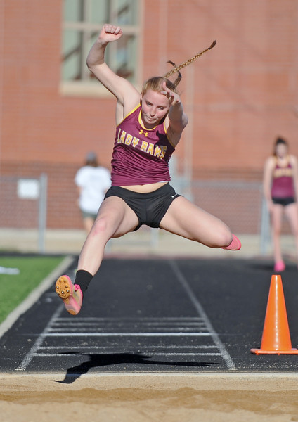 Big Horn's Emily Blaney stretches for added distance in the long jump at the Little Goose Jump and Throw Invite on Thursday, May 4 at Big Horn High School. Mike Pruden | The Sheridan Press