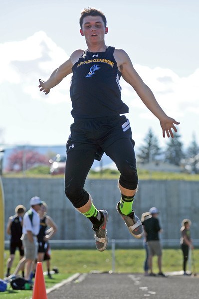 Arvada-Clearmont's Cameron Weigle hangs in the air on a triple-jump attempt during the Little Goose Jump and Throw Invite on Thursday, May 4 at Big Horn High School. Mike Pruden | The Sheridan Press