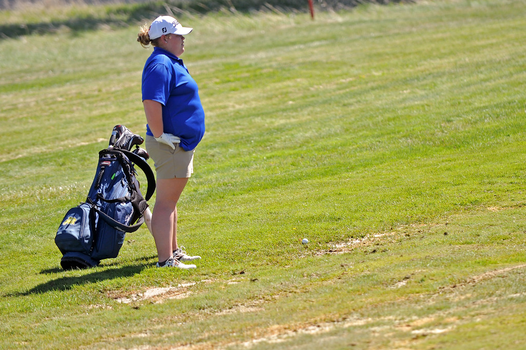 Victoria Owings ponders where to move her ball that landed in a water-damaged fairway on Friday, May 5 at Kendrick Golf Course. Mike Pruden | The Sheridan Press