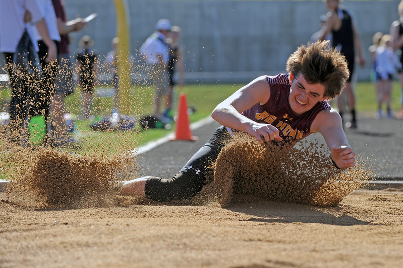 Big Horn's Jack Nance crashes into the landing pit during the boys triple jump event at the Little Goose Jump and Throw Invite on Thursday, April 4 at Big Horn High School. Mike Pruden | The Sheridan Press