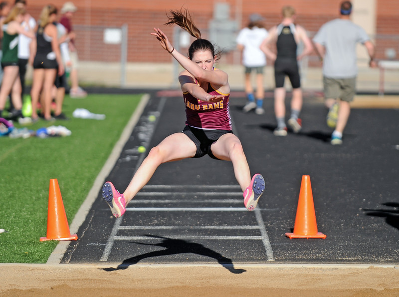 Big Horn's Katie Lambert extends during a long-jump attempt at the Little Goose Jump and Throw Invite on Thursday, May 4 at Big Horn High School. Mike Pruden | The Sheridan Press
