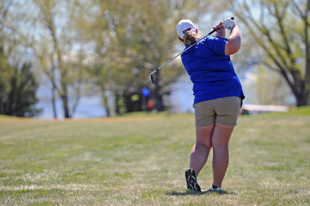 Victoria Owings watches her shot on the ninth hole on Friday, May 5 at Kendrick Golf Course. Mike Pruden | The Sheridan Press