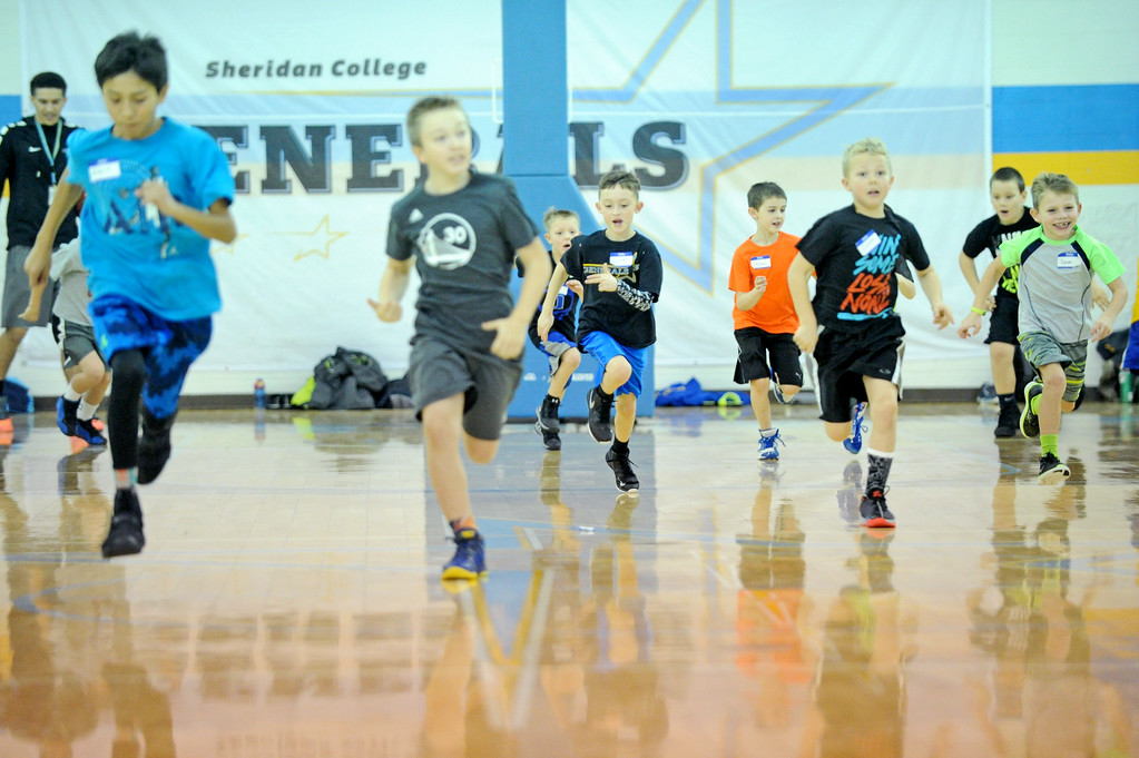 Campers sprint up the floor during the Sheridan College men's basketball camp on Saturday, Jan. 7 at the Bruce Hoffman Golden Dome. Mike Pruden   The Sheridan Press